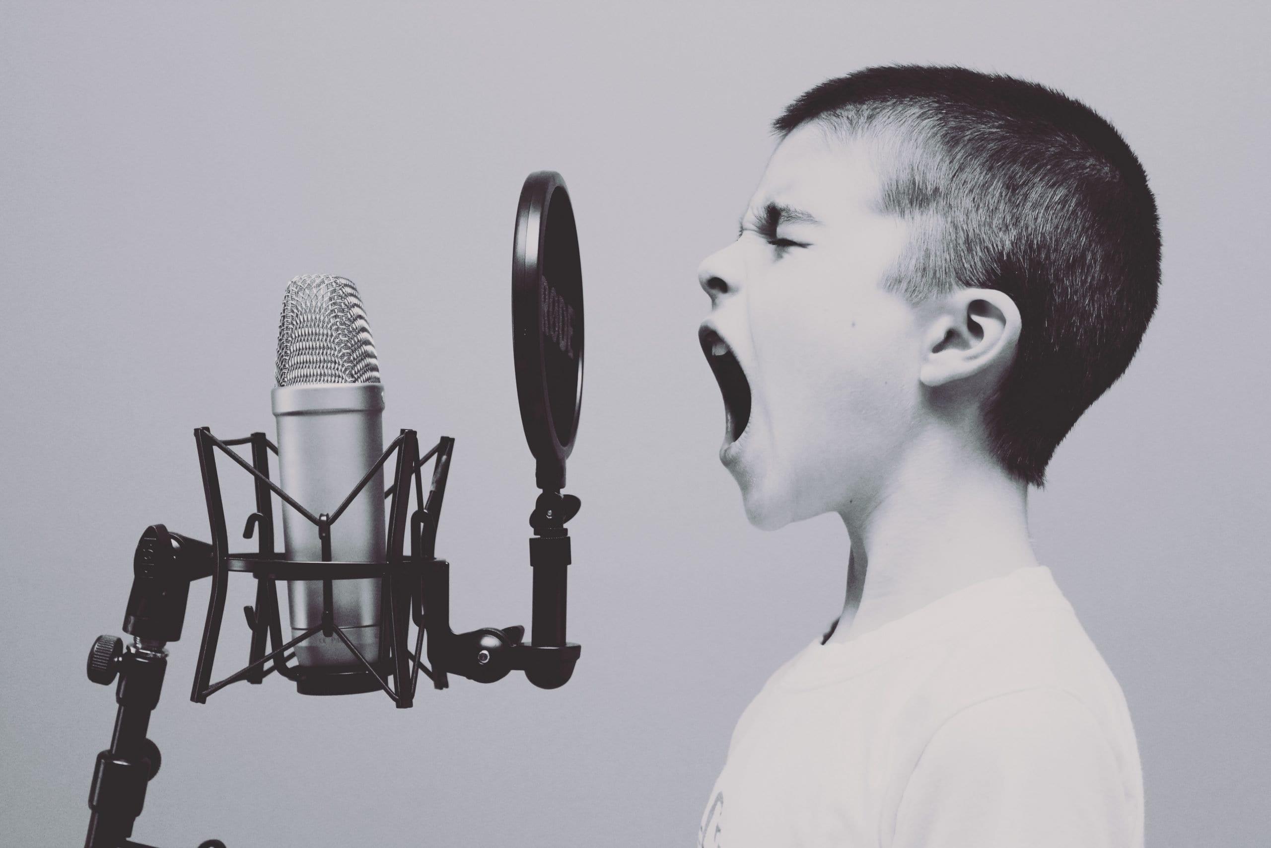 Boy screaming into a mic
